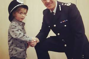 cute henry, 3, tries on cambridgeshire police chief's helmet at long service ceremony