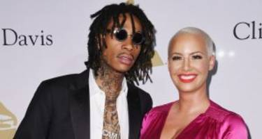amber rose and wiz khalifa get together to celebrate their son's birthday in superhero style!