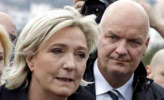 le pen's chief of staff, bodyguard detained by police
