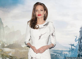 angelina jolie backtracks her comment after she's warned to stop trashing brad pitt