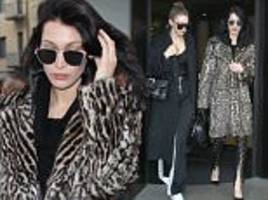 gigi and bella hadid emerge from their hotel in milan