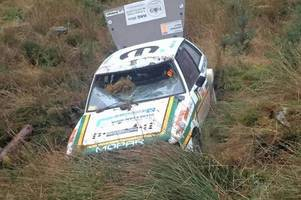 Rally drivers cheat death after five foot log smashes through window