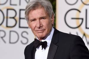 video shows the moment harrison ford flying low over an airliner taxing on a runway