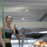 eliza mccartney wows rush-hour fans in britomart pole vault display