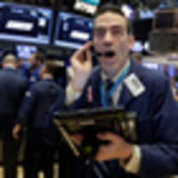 Wall St mixed, Unilever, DuPont rally