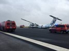 FlyBe plane crash lands on the runway at Amsterdam airport