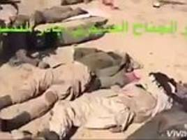 Iraqi forces line up the corpses of 30 dead ISIS fanatics