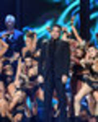 dancer suffers x-rated wardrobe malfunction during robbie williams' brits performance
