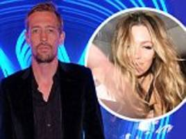 Peter Crouch helps Abbey Clancy in taxi after BRITs party