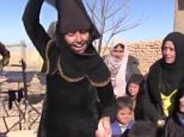 Women set fire to veils after being liberated from ISIS