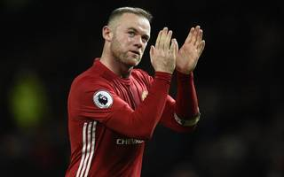 rooney confirms he is staying at manchester united