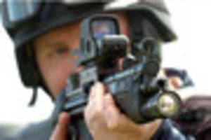 What happens when an armed police officer shoots someone?