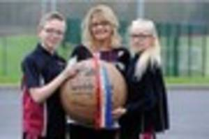 Youngsters play their own Atherstone Ball Game as Shrove Tuesday...