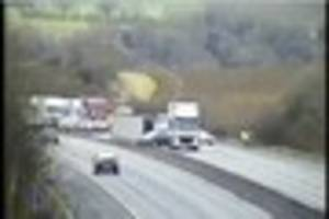 m11 blocked between junctions 8 and 9 after lorry overturns