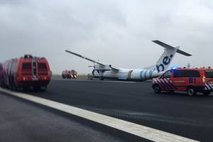 Watch as Flybe flight from Edinburgh crashes on Amsterdam runway after landing gear collapse