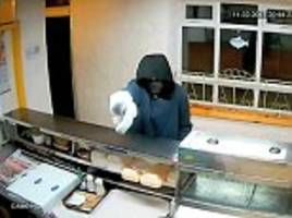 thief tries to rob takeaway with camouflaged gun