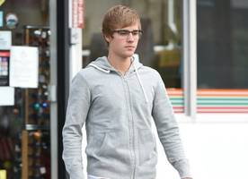 justin bieber denies peeing his pants: 'water spilled on my d**k area'