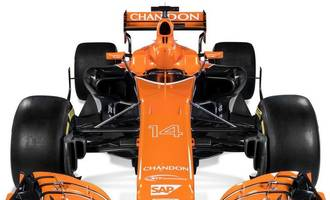 mclaren reveal orange, black & white car for 2017 season