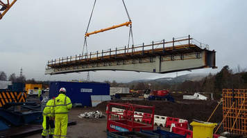 Sections of new bridge on River Ness lifted into place