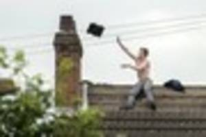 watch helicopter footage of jailed thug clint clay during rooftop...