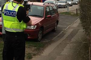 specials out in force to crack down on speeding and drivers jumping red lights in cambridge