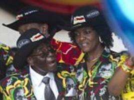 mugabe wears jacket with own face on for birthday bash