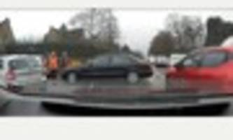 watch: derby driving instructor overtakes car during funeral...
