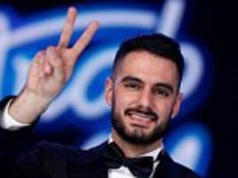 Palestinians celebrate as their compatriot wins Arab Idol