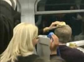 Fight on train after woman places bagel on man's head