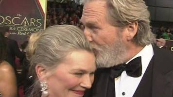 Jeff Bridges is saved from embarrassment by wife on the red carpet