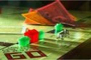 monopoly fans vote against including thimble game piece in...