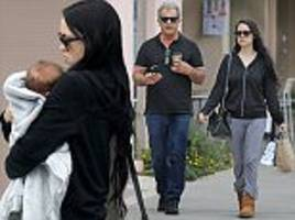 Mel Gibson and girlfriend Rosalind take baby for stroll