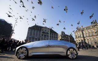 carmakers must embrace big tech to survive the driverless revolution