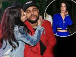 selena gomez puckers up to beau the weeknd in paris