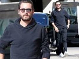 scott disick shops after kourtney is seen with mystery man