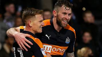 newcastle extend lead with win over promotion rivals huddersfield