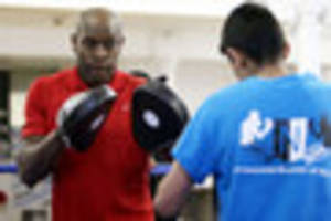 boxing legend frank bruno steps into the ring at the nottingham...