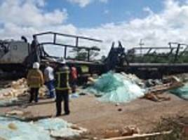 lorry overturned onto a funeral procession in zimbabwe