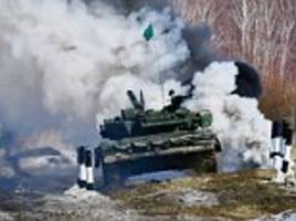 russian soldiers compete in a tank obstacle course