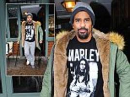 david haye hobbles out of the ivy on crutches