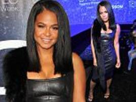 christina milian wears leather dress at fashion bash