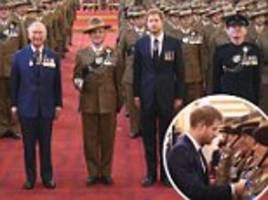 Charles and Harry present medals to Gurkha soldiers