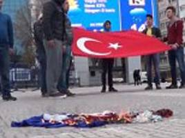 turkish president's supporters burn a french flag