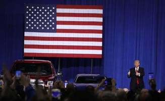 in michigan visit, president trump reopens review of fuel-economy standards