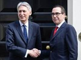 smiling hammond meets us counterpart after budget shame