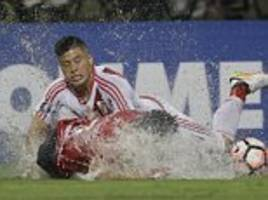 river plate play copa libertadores game in torrential rain