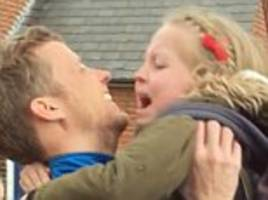 little girl overwhelmed with emotion she sees her father