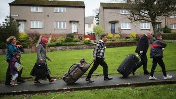 Syrian refugees arrive in Scotland on Glasgow chartered flight