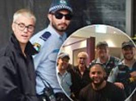 Justin Bieber mobbed by police