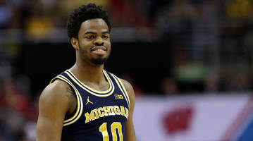 meet the man who helped transform michigan's derrick walton (and tom brady, desmond howard and michael phelps, too)